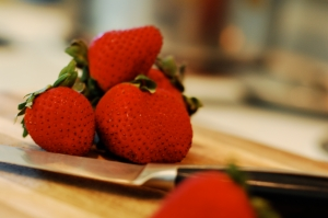 strawberries on cutting board